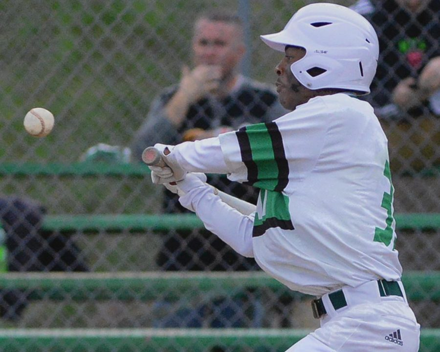 Harlan%27s+Trey+Barnes+went+after+a+pitch+in+the+Green+Dragons%27+game+Tuesday+against+visiting+Leslie+County.+The+Eagles+rallied+for+a+7-6+victory.
