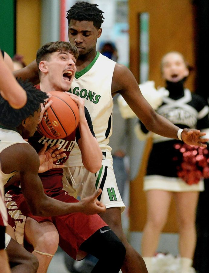 Harlan County's Tyler Cole worked inside for a shot against Harlan in the 52nd DIstrict Tournament finals Friday. Cole led the Bears with 19 points in a 61-55 loss.