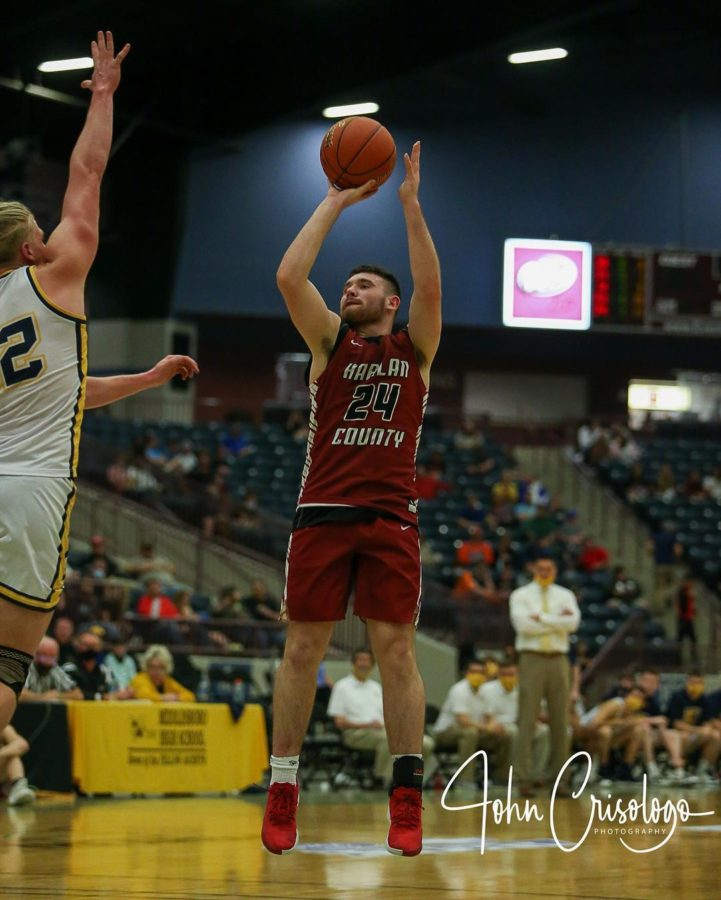 Harlan County senior Josh Turner put up a shot in regional tournament action Tuesday.