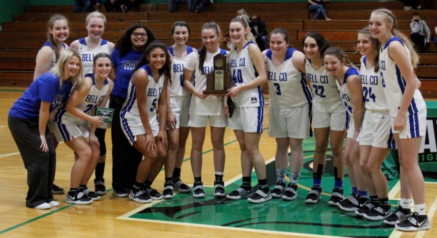 The Bell County Lady Cats are pictured with their district championship trophy after defeating Harlan County 62-55 on Thursday.
