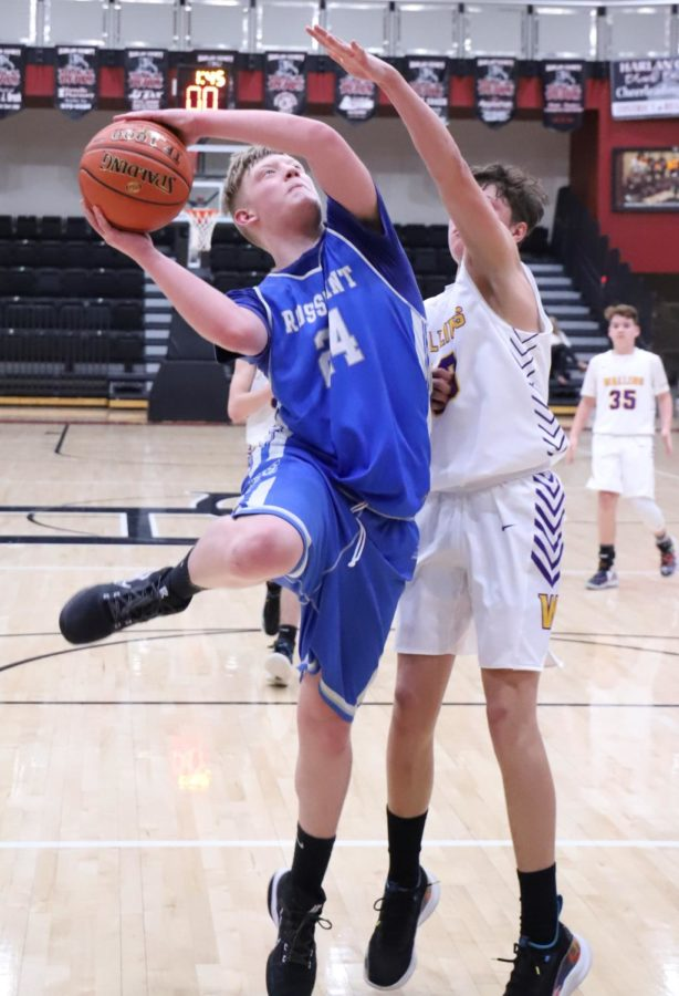 Rosspoint's Blake Hensley went up for a shot against Wallins' Hunter Napier in the seventh- and eighth-grade county finals Tuesday.