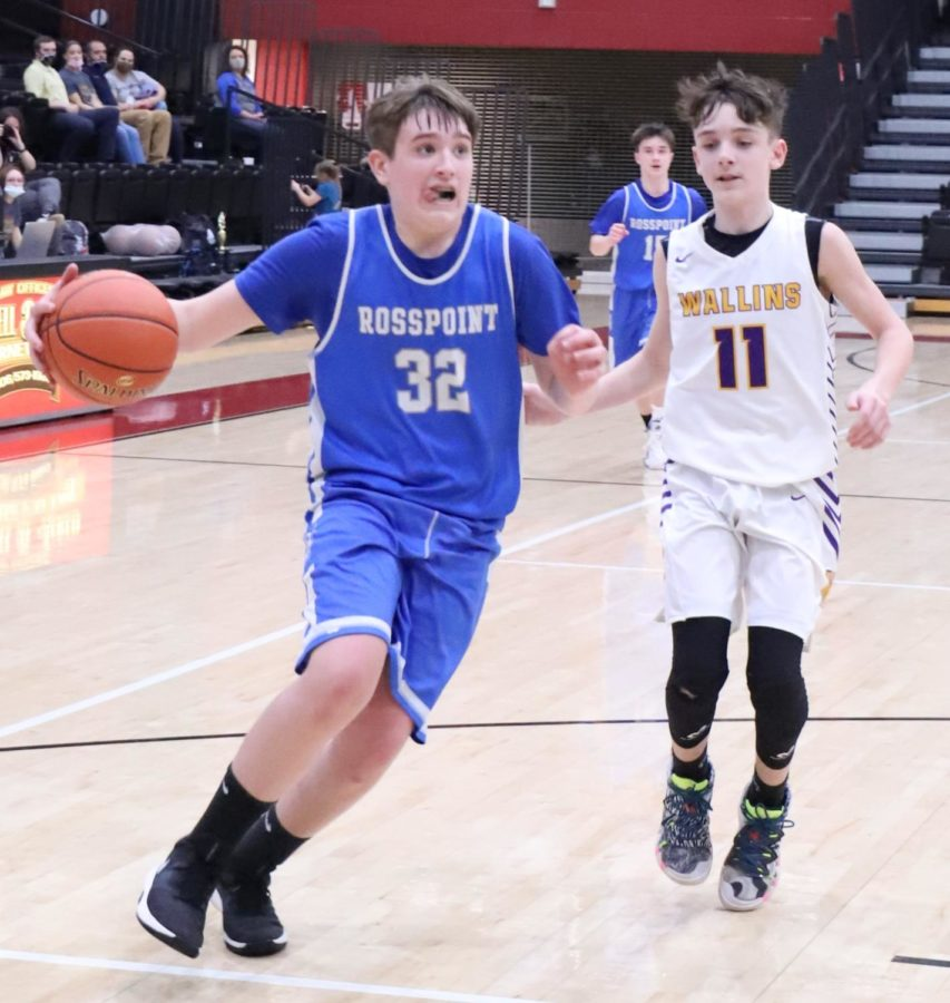 Rosspoint's Brody Napier drove past Wallins' Trenton Cole in action from the seventh- and eight-grade county tournament finals Tuesday.