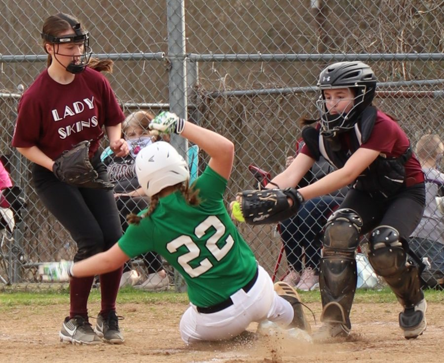 Harlan%27s+Ella+Lisenbee+beat+the+tag+from+Cumberland+catcher+Kasady+Hall+in+middle+school+softball+action+earlier+this+week.+Harlan+won+6-5+in+four+innings.