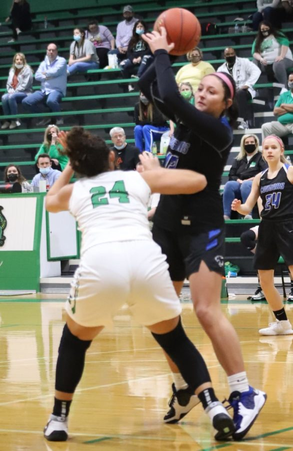 Letcher Central's Kaylee Banks passed over Harlan's Aymanni Wynn in Monday's game. Letcher Central improved to 13-11 with a 58-41 victory.