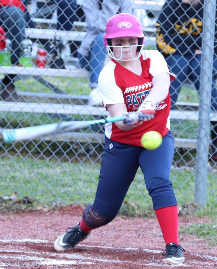 Lyndsey Skidmore connected on a pitch against visiting Harlan on Monday. The Lady Dragons won 17-14.