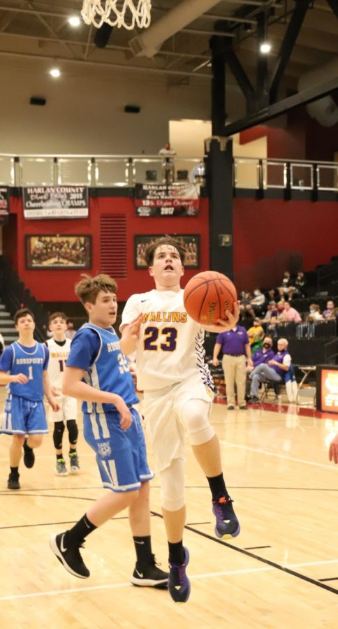Wallins' Evan Simpson went past Brody Napier, of Rosspoint, in the seventh- and eighth-grade county championship game Tuesday.