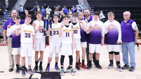 The Wallins Purple Devils completed a perfect season and won the county championship in the seventh- and eighth-grade division by defeating Rosspoint 64-60 on Tuesday at Harlan County High School. Team members include, from left, coach Robert Simpson, Keaton Simpson, Ethan Simpson, Hunter Napier, Evan Simpson, Trenton Cole, Connor Daniels, Tatten Rice, coach Johnny Murphy, Travis Burkhart, Aaron Johnson and coach Robert Simpson.