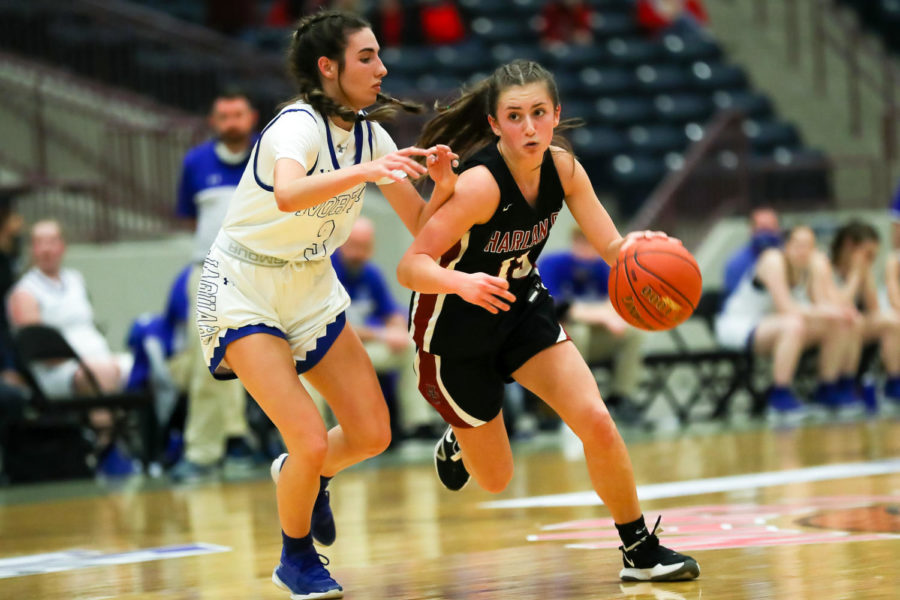 Harlan County point guard Ella Karst worked against North Laurel's Hailee Valentine in the 13th Region Tournament semifinals on Saturday at The Corbin Arena. Valentine scored 23 points in North's 65-38 win.