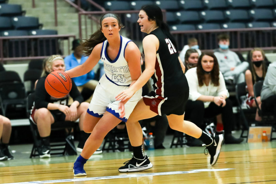 North Laurel's Emliy Sizemore drove past Harlan County's Jaylin Smith in the 13th Region Tournament semifinals Saturday. Sizemore scored 10 points in the Lady Jaguars' 65-38 victory.