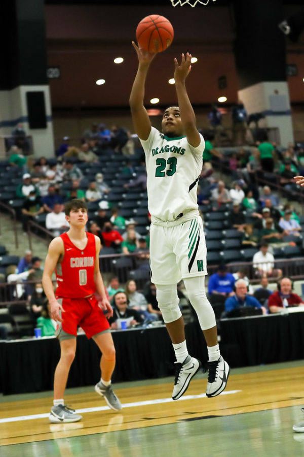 Harlan's Jaeden Gist went up for a basket against Corbin in 13th Region Tournament action Monday.