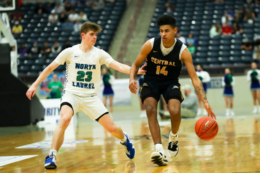 Knox Central guard Jevonte Turner worked against North Laurel's Brody Brock in the 13th Region Tournament finals. Turner scored 12 points in the Panthers' 78-63 victory.