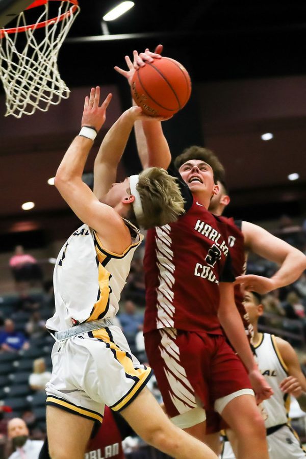 Harlan County eighth-grade guard Maddox Huff went up for a block in 13th Region Tournament action Tuesday.