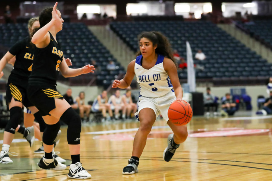 Bell County guard Nadine Johnson looked for an opening in Thursday's regional tournament game against Clay County. Johnson scored 18 points in Bell's 58-26 win.