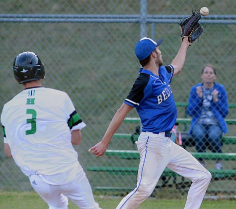 Bell pitcher Hayden Clark took the throw at the plate as Harlan