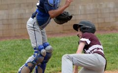 Cumberland's Josh Duckworth slid home in front of New Harlan catcher DaShaun Smith in the Redskins' win in middle school baseball action at Harlan County High School.