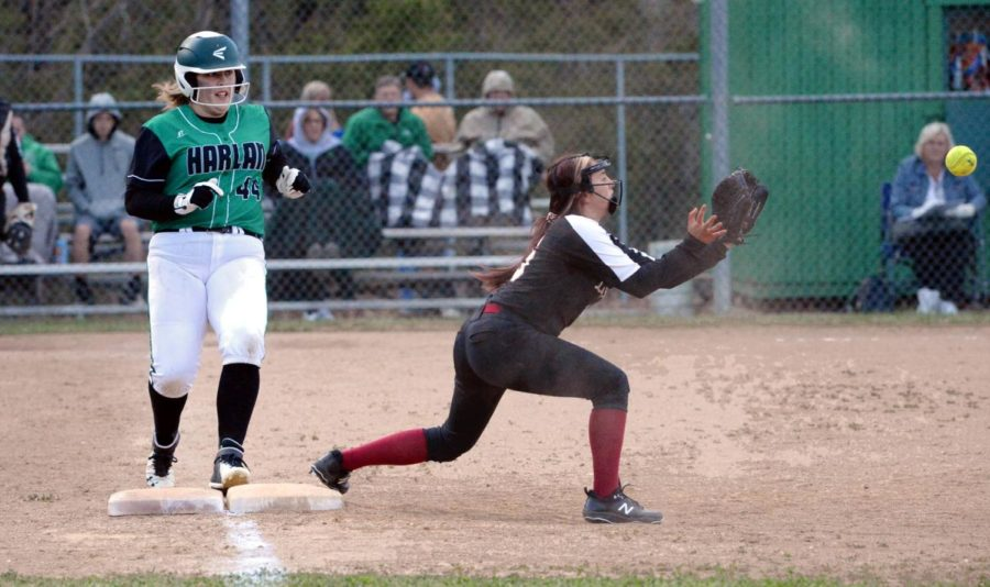 Harlan+County+first+baseman+Emily+Day+took+a+throw+to+retire+Harlan%27s+Carli+Jo+Kennedy+in+district+action+Thursday.