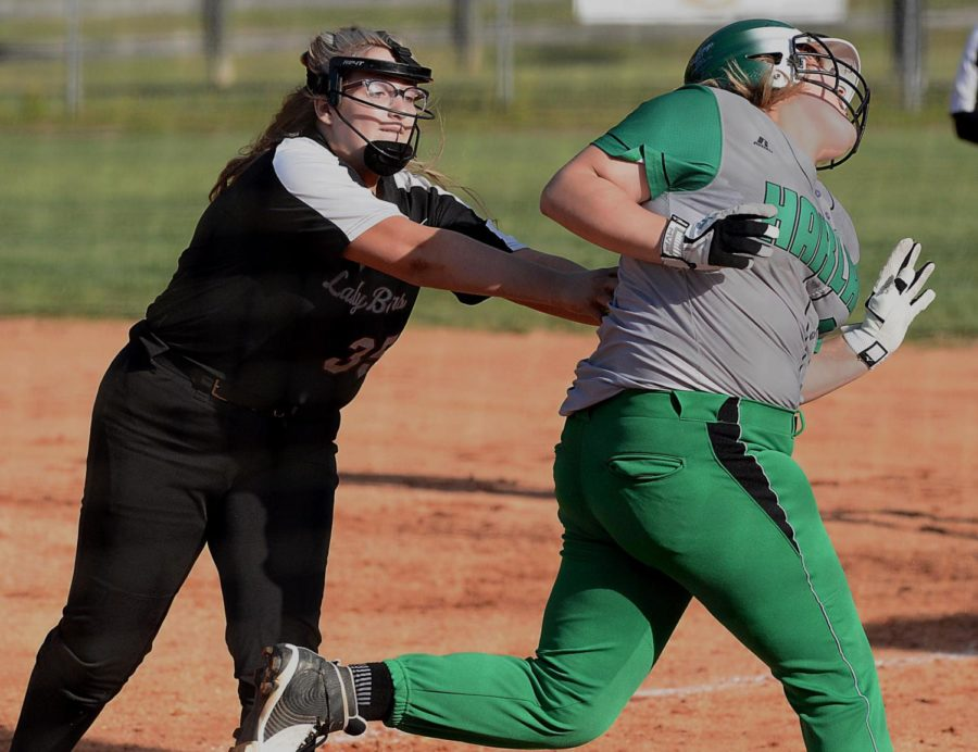 Harlan+County+first+baseman+Emily+Day+tagged+out+Harlan%27s+Carli+Jo+Kennedy+in+Friday%27s+game+at+HCHS.+The+Lady+Bears+won+15-0+in+four+innings+to+improve+to+7-2+on+the+season.