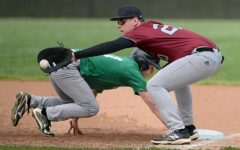 Harlan County's Karsten Dixon took a throw from pitcher Brayden Blakley as Shane Lindsey hustled back to first base.