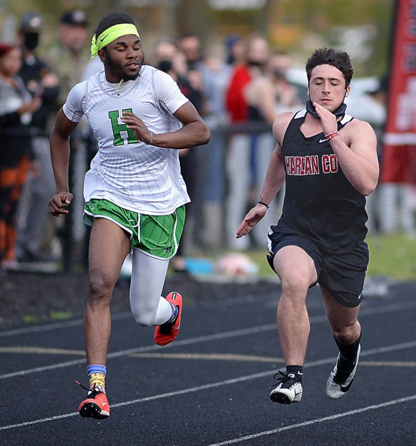 Harlan's Johann GIst and Harlan County's Luke Carr headed toward the finish line in one of the sprints Friday.