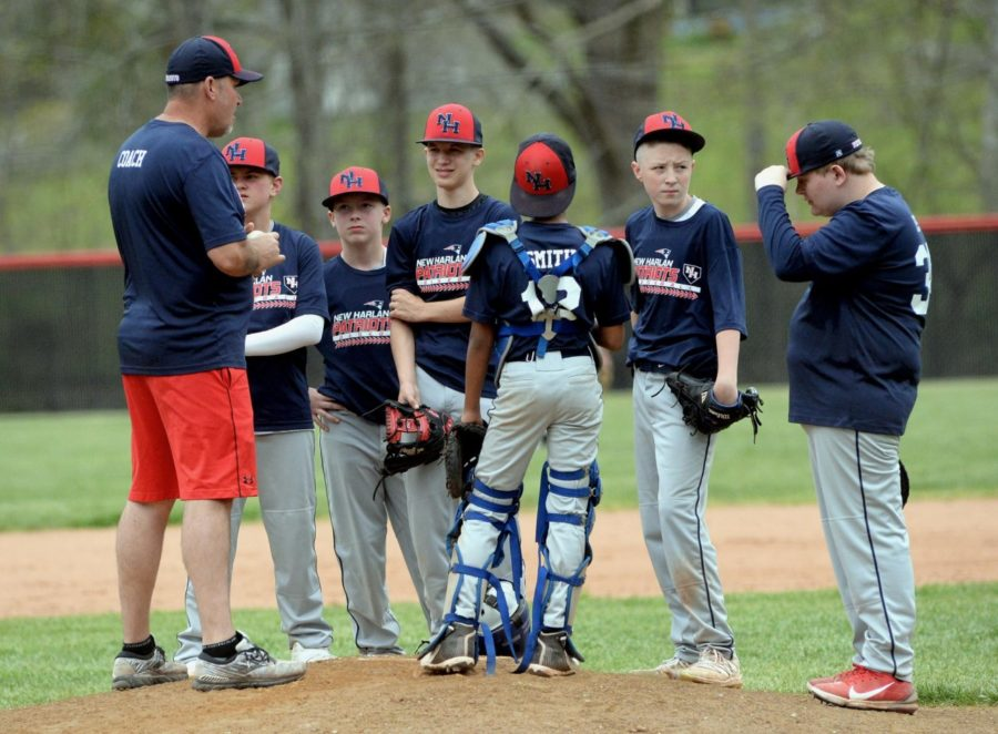 New Harlan coach Jamie Johnson talked to Chance Sturgill, Brayden Morris, Jake Brewer, DaShaun Smith, Gunnar Johnson and Bryce Mabes during Saturday's game against Cumberland in a meeting at the mound.