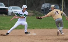 Harlan's Jeremiah Mills was safe at second base in action earlier this season. The Green Dragons fell 8-3 to Lynn Camp on Tuesday.