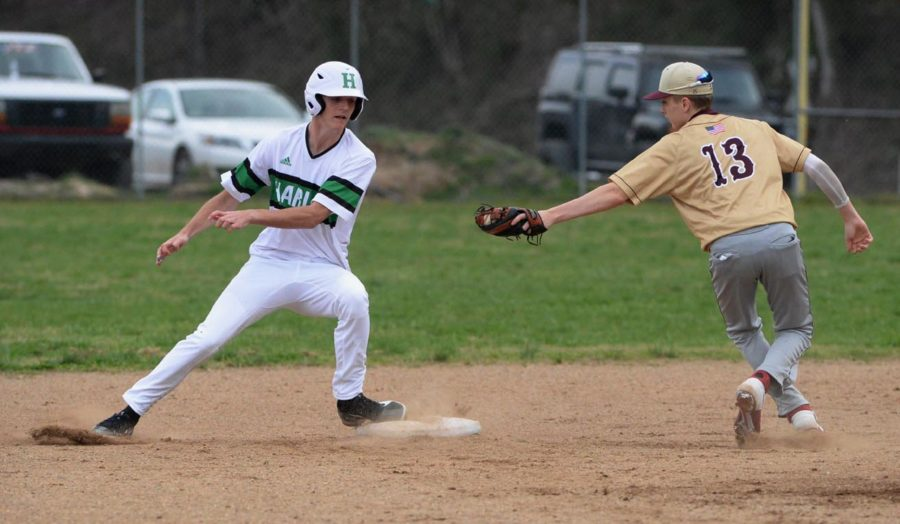 Harlan%27s+Jeremiah+Mills+was+safe+at+second+base+in+action+earlier+this+season.+The+Green+Dragons+fell+8-3+to+Lynn+Camp+on+Tuesday.