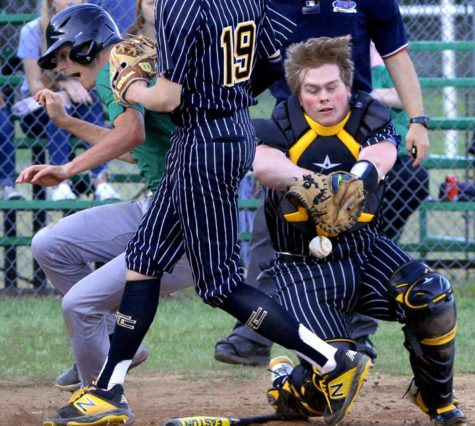 Jeremiah Mills, of the Harlan Green Dragons, dislodged the baseball from the mitt of Clay County