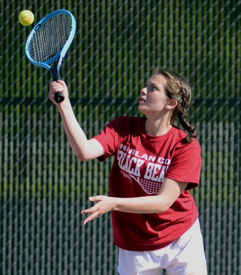 Harlan County's Lindsay Hall returned a shot in action Monday against Harlan.