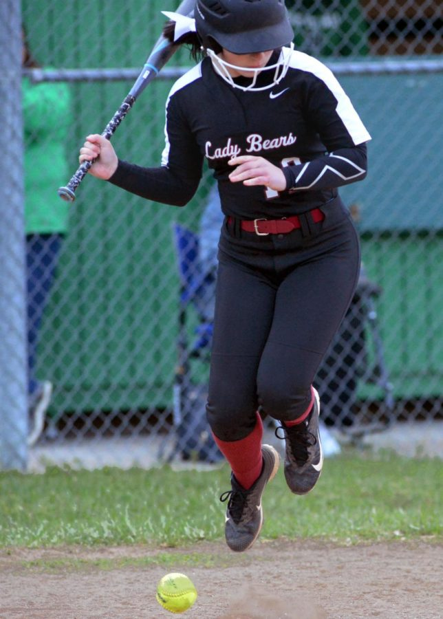Harlan County freshman Rylie Maggard jumped to avoid a pitch in Thursday's district clash at Harlan. Maggrd had a hit in the Lady Bears' 19-0 win.