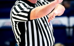 Harlan County resident Darrell Wilson is one of the officials representing the 13th Region at this year's girls state tournament at Rupp Arena. Wilson is pictured making a call during the Anderson County/Southwestern game on Wednesday night.