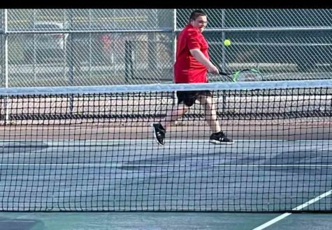 Harlan County freshman Calan Neely returned a shot in tennis action Monday at Harlan. Both HCHS teams claimed wins.