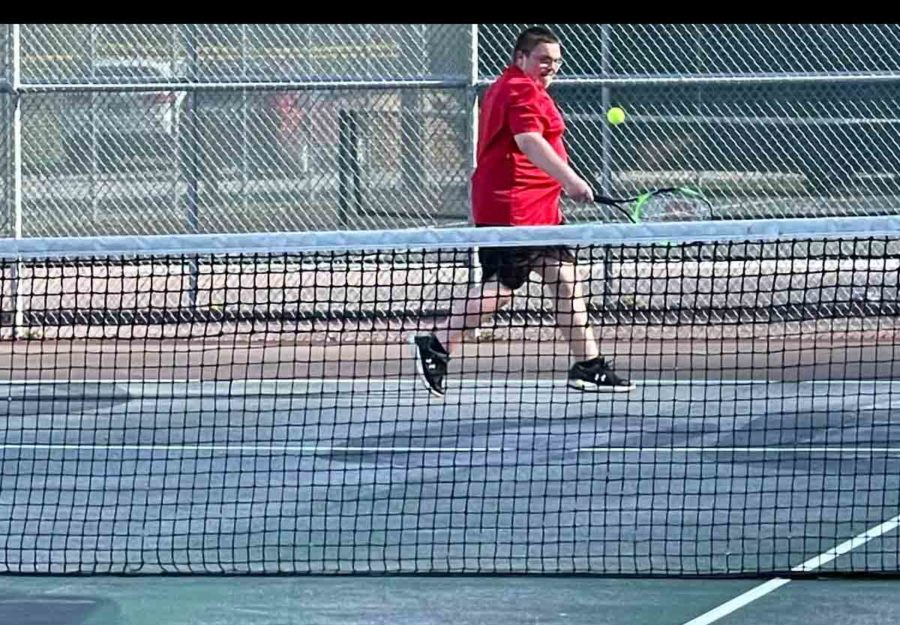 Harlan+County+freshman+Calan+Neely+returned+a+shot+in+tennis+action+Monday+at+Harlan.+Both+HCHS+teams+claimed+wins.