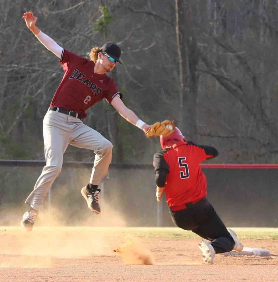 Perry Central's Dustin Fields slid under a tag for a stolen base in Tuesday's game against Harlan County as shortstop Brayden Blakley went airborne for the throw and tag.