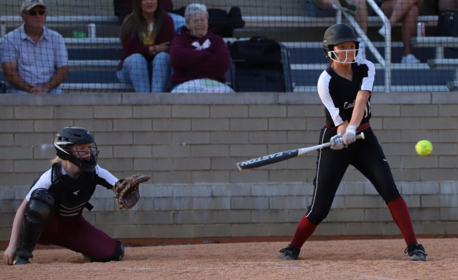 Jacey Lewis went after a pitch in Tuesday's game against Leslie County. Lewis had the game-tying hit as the Lady Bears rallied for a 10-9 win.