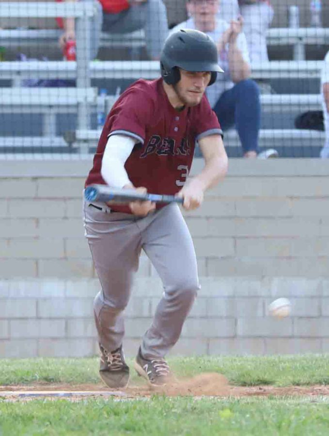 Harlan County second baseman Josh Swanner beat out a bunt single in Tuesday's game against visiting Perry Central.