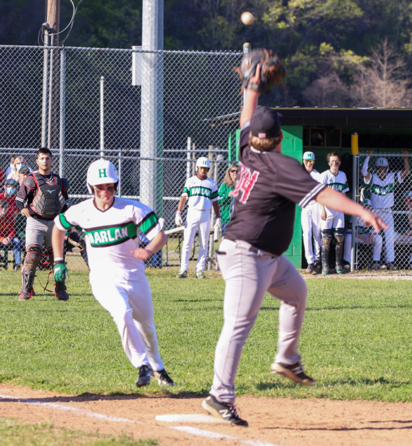 Harlan County first baseman Will Cassim took the throw from catcher Isaac Kelly to retire Harlan's Shane Lindsey after his sacrifice bunt in the first inning on Monday's game.