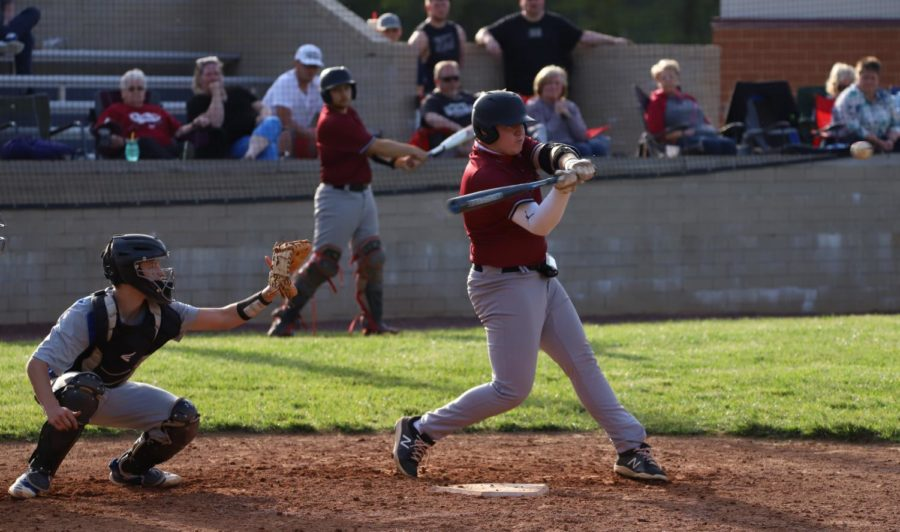 Senior+third+baseman+Zac+Collett+connected+on+a+pitch+Monday+in+Harlan+County%27s+15-5+six-inning+win+over+visiting+Bell+County.+The+Bears+downed+Bell+11-1+on+Tuesday+at+Log+Mountain.