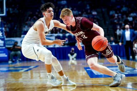 Ashland junior guard Ethan Sellars drove to the basket in state tournament action Friday against Boyle County. Sellars, a junior guard, averaged 13.5 points per game this season for the Tomcats. Sellars is the son of Jamey Sellars, a former Lynch resident and Cumberland High School student. Sellars
