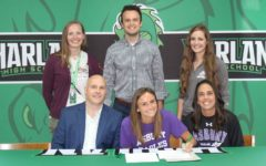 Ella Morton signed with Asbury University on Monday to continue her cross country and track career. Pictured with Morton at the signing ceremony are her parents, C.D. and Jennifer Morton, as well as Harlan coaches Anne Lindsey and Trevor Fitzpatrick and Asbury assistant coach Molly Halpin; not pictured: Harlan assistant coach Mike Pace.