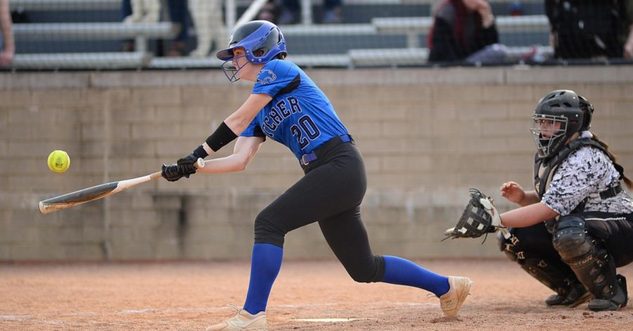 Letcher Central center fielder Abigail McDougal connected on a pitch in Tuesday's game at Harlan County. McDougal had a single and sacrifice fly in the Lady Cougars' 13-7 win.