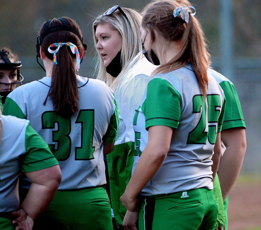 Harlan coach Alex Pennington talked to the Lady Dragons during a game earlier this season. Harlan claimed its first win of the season on Thursday with a 16-1 victory over Barbourville.