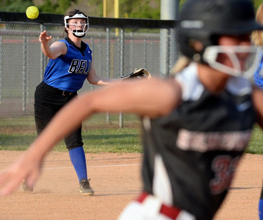Harlan County's Allee Galloway raced toward first base as a Bell County infielder made a throw in Monday's district clash.