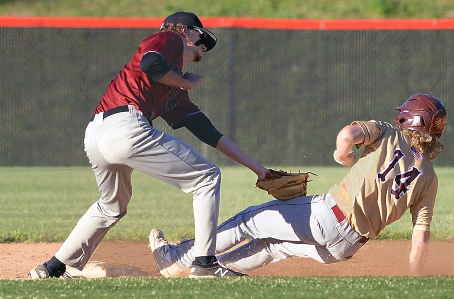 Harlan County shortstop Brayden Blakley tagged out Leslie County's Dillion Smith on a steal attempt in Wednesday's game.