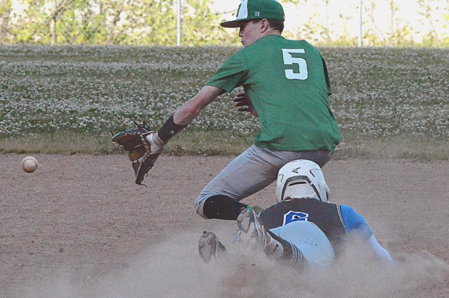 Harlan shortstop Evan Browning fielded a throw as Letcher Central's Christopher Akers slid safely into second base during Thursday's game. Akers scored a run and drove in a run in Letcher's 9-6 win.