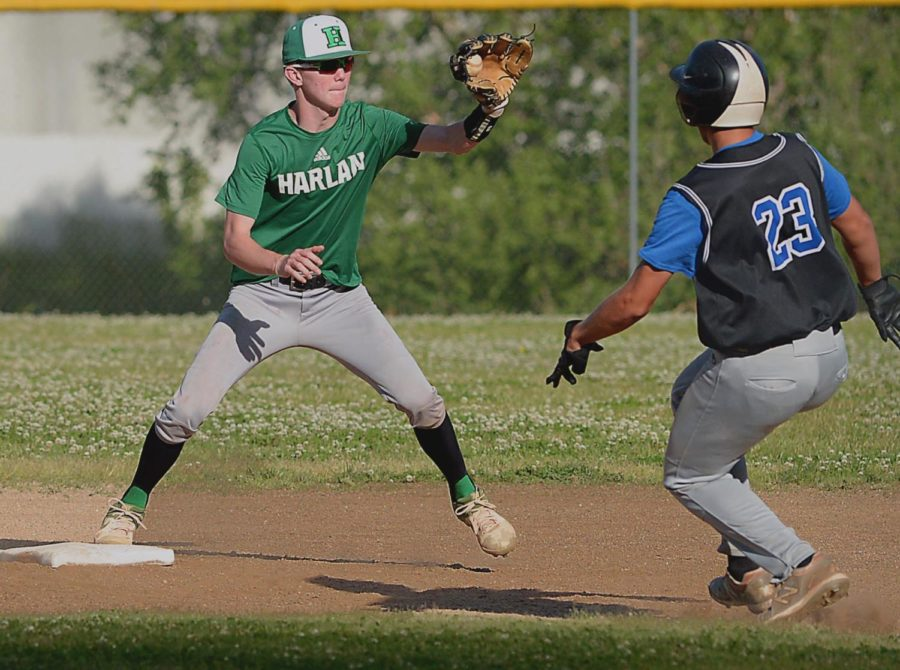 Harlan+shortstop+Evan+Browning+took+a+throw+at+second+base+to+retire+Letcher+Central%27s+Preston+Helle+in+Thursday%27s+game.