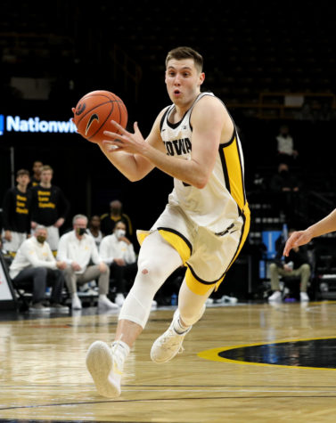 Iowa guard CJ Fredrick (5) is pictured against the Rutgers Scarlet Knights  at Carver-Hawkeye Arena.