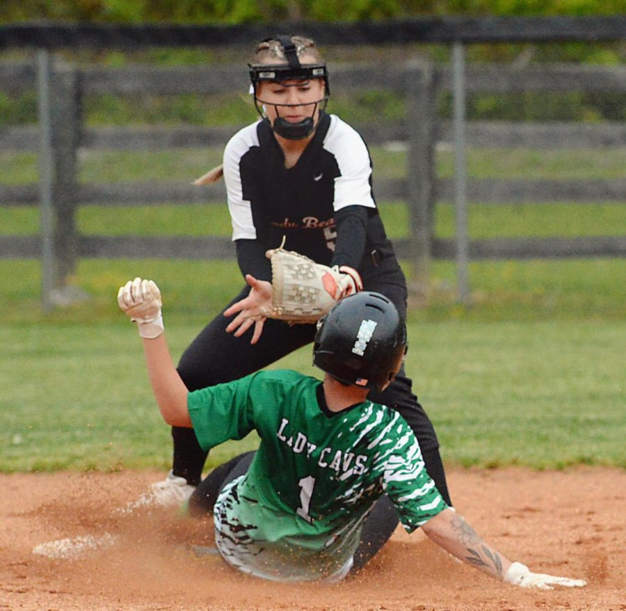 Jenkins' Jerrica Thacker beat the tag of Harlan County second baseman Maddy Blair during Tuesday's game.