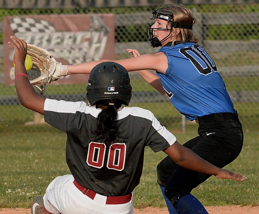 Harlan County's Joselyn Lee was safe on steal attempt as Bell County's Camille Thomas took the throw in Monday's game at HCHS.