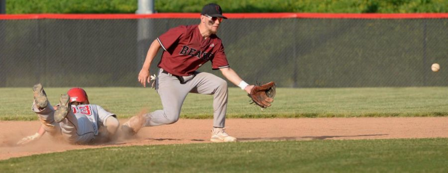 Harlan County second baseman Josh Swanner fielded a throw in Friday's game against Whitley County.