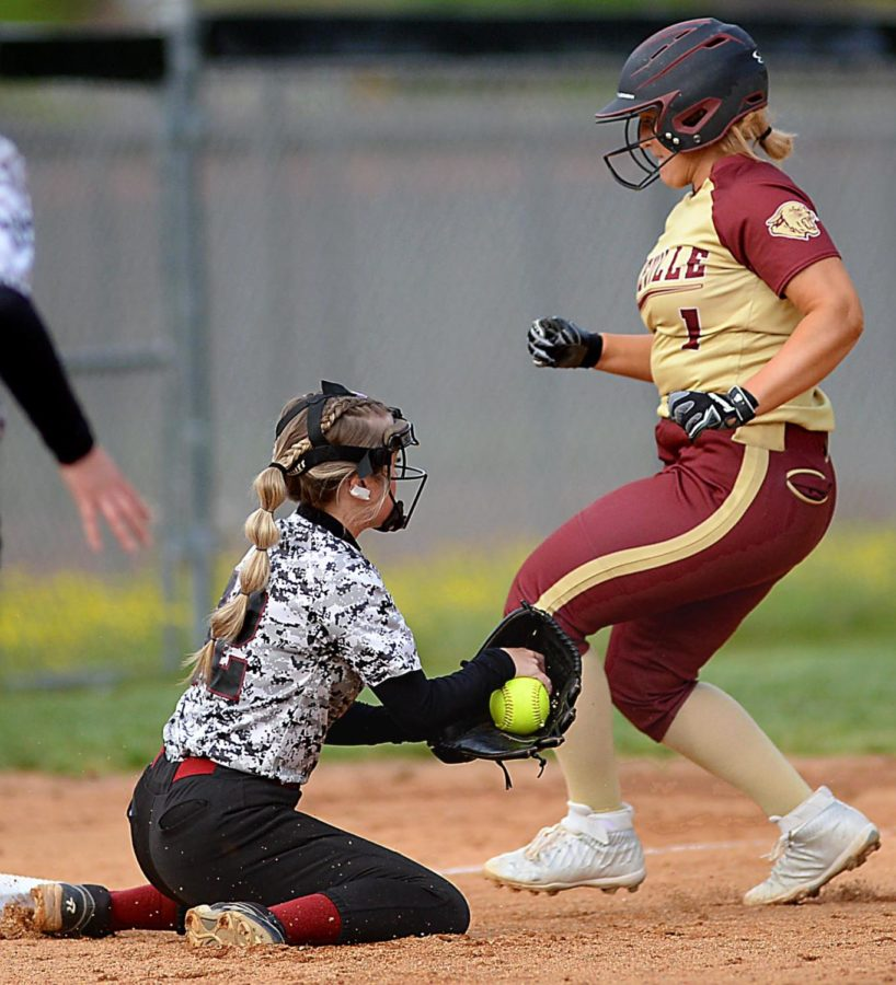 Pineville's Virginia Hall advanced to third base ahead of the tag of Allee Galloway in softball action Thursday. The visiting Lady Lions won 3-0.